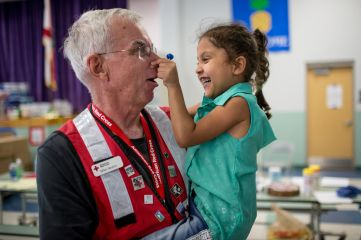September 21, 2017. Sugarloaf Key, Florida. Red Cross volunteer Mike Nealon visits with Mileyshka, 5, at the Red Cross shelter in Sugarloaf Key, Florida. Photo by Marko Kokic for The American Red Cross